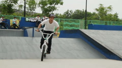 Extreme Sports BMX Bicycle Rider Doing Tricks on Bike - stock footage