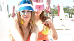 Two women dancing at the beach in bikinis - stock footage