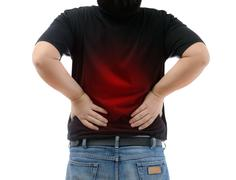 Young man suffering from strong backache - stock photo
