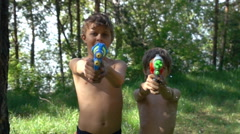 Children playing water guns Stock Footage