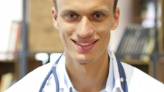 Portrait of friendly male doctor smiling in Clinic - stock footage