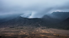 Steam and smoke rising from crater of Bromo volcano 4K time lapse background  Stock Footage