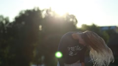 Attractive young woman silhouette dancing outdoors on a sunset with sun shining - stock footage