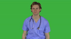 Expressionless male medical worker (Green Key) Stock Footage