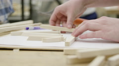 Close up of hands - student in shop class doing woodwork - stock footage