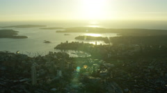 Aerial sunrise view of Sydney Harbour Bridge and ferry harbor Australia Stock Footage