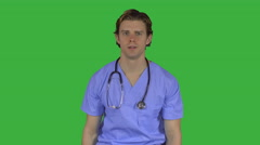 Stressed man in medical clothing (Green Key) - stock footage