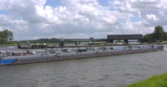 Inland tanker takes exit to the Lek canal, a branch of the Amsterdam-Rhine canal Stock Footage