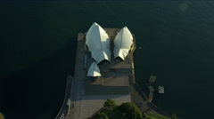 Aerial view at sunrise of Sydney Opera House and Circular Quay Australia Stock Footage