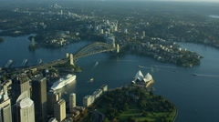 Aerial sunrise view of Sydney Harbor Bridge and Opera House Stock Footage