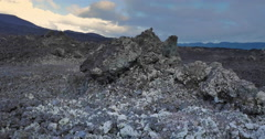 Scenic deserted rocky land of extreme nature volcanic terrain in volcano crater - stock footage