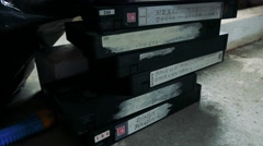 Old video cassette stand on the floor Stock Footage