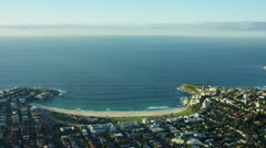Aerial view of sweeping bay at Bondi Beach Australia Stock Footage