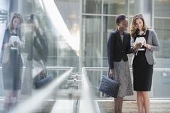Corporate businesswomen using digital tablet Kuvituskuvat