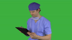 Male medical worker smiles (Green Key) - stock footage