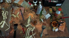 Disorder on table with art and painting materials Stock Footage