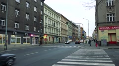 Crossroads with cars and pedestrian in town Stock Footage