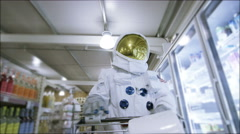 4K Off duty astronaut walking through supermarket, shopping for groceries Stock Footage