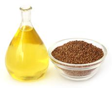 Ajwain seeds in a glass bowl with essential oil Stock Photos
