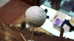 Golf ball with signature  stands on wooden skewer  Stock Footage