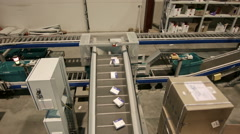 Medications move along a conveyor belt in the warehouse of the pharmacy Stock Footage