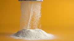 Sifting flour in slow motion Stock Footage