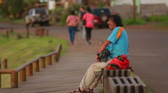 Man resting on a bench in Easter Island Stock Footage