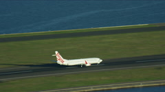 Aerial view of a commercial plane taking off from Sydney International Airport Stock Footage