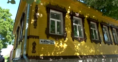 Yellow house with carved platbands on the Windows in Suzdal - stock footage