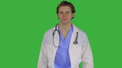 Serious medical pro hands on hips (Green Key) Stock Footage