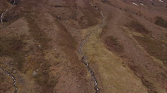 Aerial Of Streams To Waterfall Off Of Hughe Cliff In Seyðisfjörður Iceland Stock Footage