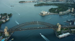 Aerial view of Opera House and traffic on Sydney Harbour Bridge at sunset Stock Footage