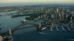 Aerial sunset view of Sydney Harbor Bridge and Opera House Stock Footage