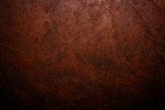 Old vintage dark brown leather background and texture; for horror haunted house  - stock photo