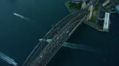 Aerial view of Sydney Harbor Bridge and Opera House sunset Stock Footage