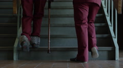 Physiotherapy - Teaching to walk with cane on stairs - stock footage