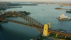 Aerial view of Sydney Harbor Bridge climb at sunset Australia Stock Footage