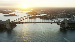 Aerial view of Sydney Harbor Bridge at sunset Australia Stock Footage