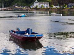 Colourful boats in l;ate afternoon sun at Tobermory, Isle of Skye, Scotland, Stock Photos