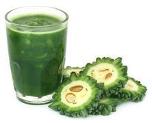 Herbal juice of green momodica Stock Photos
