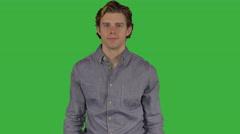 Nice looking man crosses arms (Green Key) Stock Footage