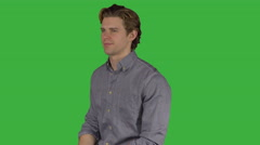 Confident young man in grey shirt (Green Key) Stock Footage