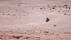 Man driving through the Atacama Desert on his motorcycle, Chile Stock Footage