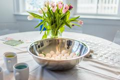 Bowl of hard boiled eggs prepared for food colour dye at Easter Stock Photos