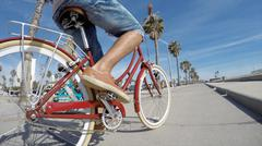 Cropped view of couple cycling at Venice Beach, California, USA Kuvituskuvat