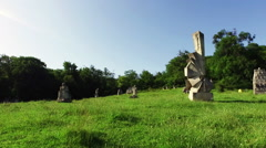 Stone Sculptures On A Green Field In Magura,Romania,walking Stock Footage