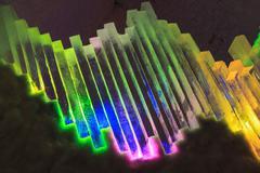 Stack of ice blocks lit with colourful lights near Fairbanks, Alaska - stock photo