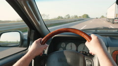 Driving Safe with Hands Firmly Holding the Wheel Stock Footage