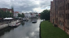Cruise ship at the Trave river in Lübeck - stock footage