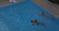 Father, mother and child bathing in the pool Stock Footage